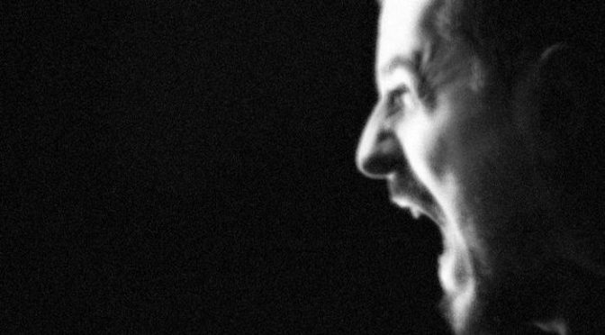 scream-loud-man-on-a-dark-background_5120x2880